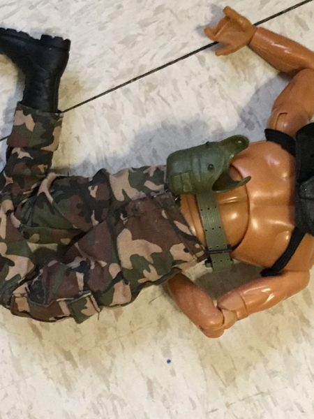 Ken doll crumpled on floor